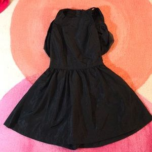 Black romper with an outer skirt layer, open back